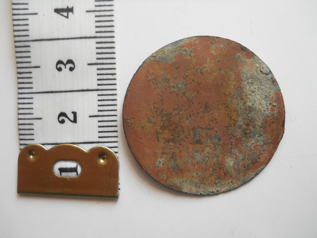 Старинный жетон uku.