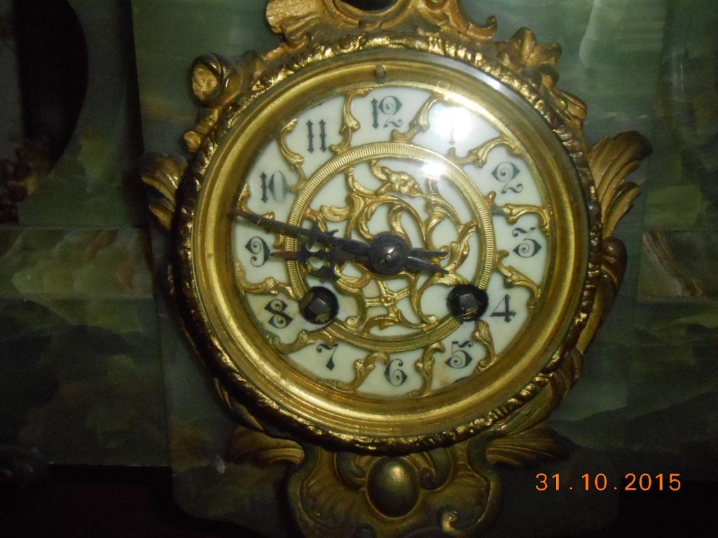 Часы и канделябры. Европа. Землепашец. Оникс.