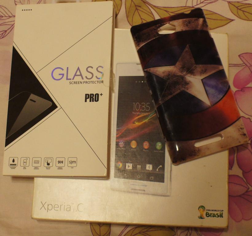 Новый чехол, защитное стекло, коробка с документами от Телефона Sony Xperia C
