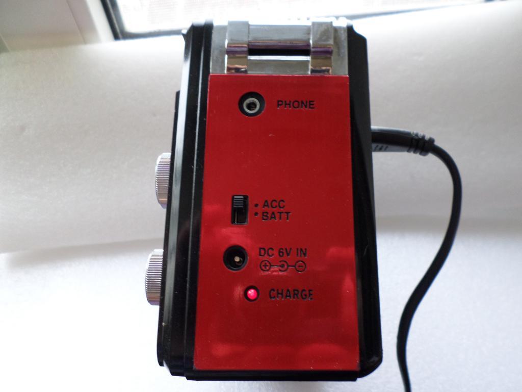 Ritmix RPR-202  Радиоприёмник - плеер.