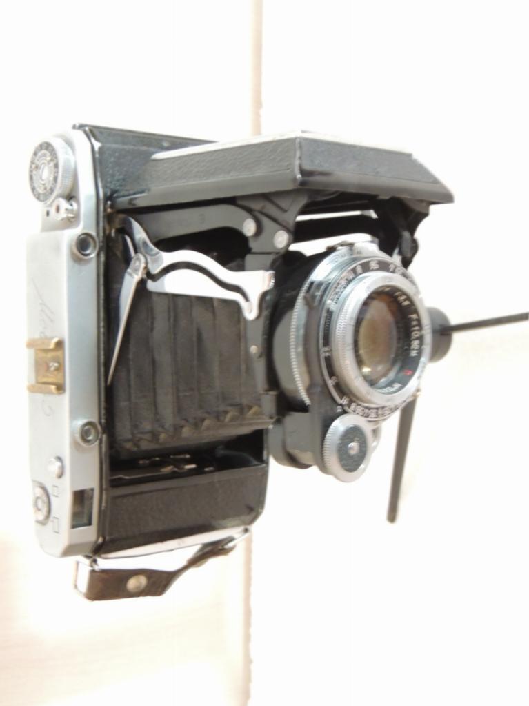 старые советские фотоаппараты гармошка лет она ведет