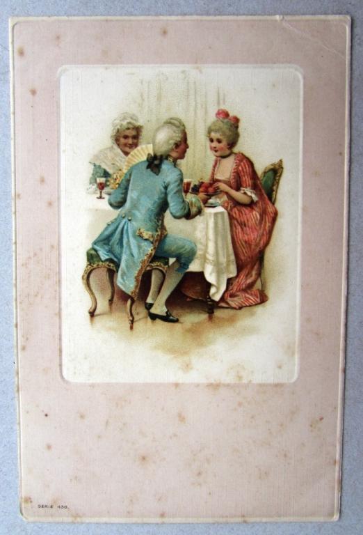 Девушка и кавалер за столом в праздничных одеждах