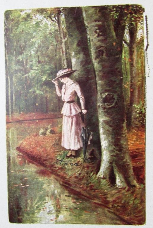 Девушка с зонтом на берегу лесной реки Германия