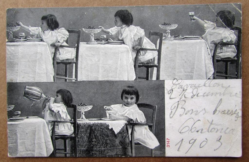 Девочка за столом с фужером и фруктами в вазе