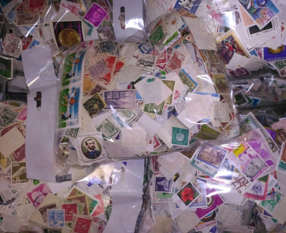 10000 иностранных марок всех континентов в большом ассортименте в запаянных пакетах