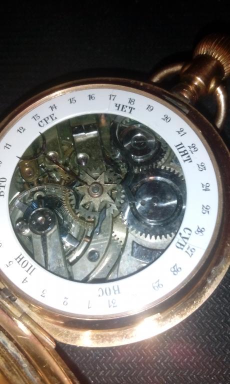 редкие антикварные часы с лунным календарем