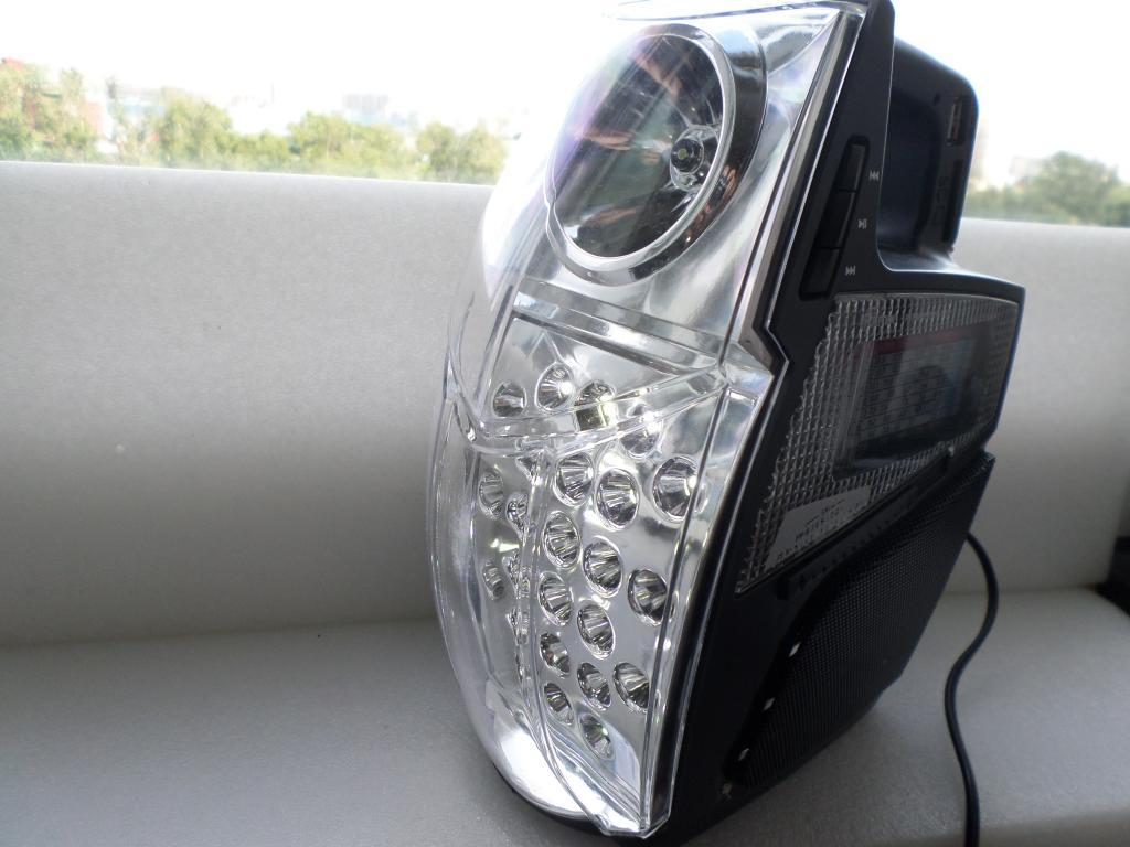 Ritmix RPR-555 Радиоприёмник-плеер.