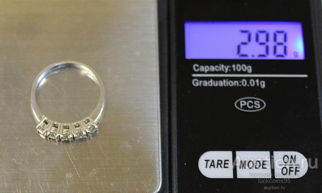 Кольцо из белого золота с 5-ю бриллиантами. Общая каратность 0,75 Карат. Золото 750 - 2.98 грамм.